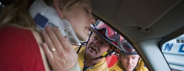 Rescuers Helping Woman in Car Accident with Neck Injury